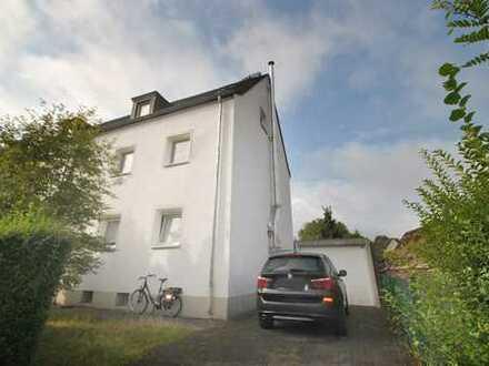 Erdgeschoßwohnung in ruhiger Wohnlage mit eigenem Garten, Kamin und Garage!