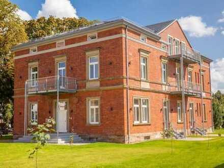 Residieren statt Wohnen: stilvolle 3-Zi –Wohnung in Villa, mit Terrasse und Garten