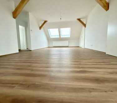 Erstbezug: schöne 4-Zimmer-DG-Wohnung mit Dachloggia in Östringen