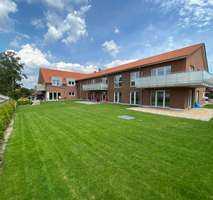 Bissendorf - Moderne große Neubau 3 Zi.-Wohnung mit eigenem Garten, Tiefgarage, EBK, Aufzug