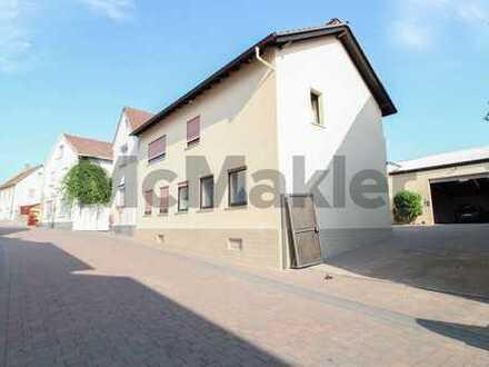Wohnen und Arbeiten unter einem Dach: ZFH mit großem Innenhof und Gewerbehalle in ruhiger Lage