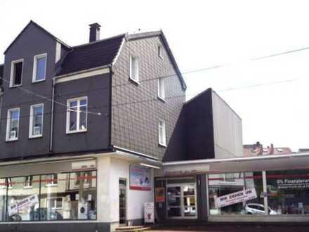 Grundstück ca. 1200 m², mit MFH, Gewerbe und 5 Garagen