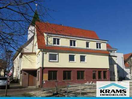 Wohn- und Geschäftshaus mit Baugrundstück