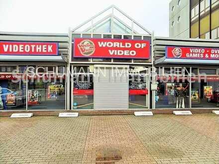 725 m² Verkaufs-/Bürofläche, An-und Auslieferung über Rolltor, günstige Miete