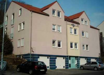 Gepflegte Dachgeschosswohnung mit drei Zimmern sowie Balkon und Einbauküche in Randersacker