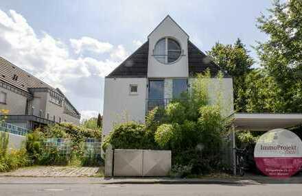 Große Maisonettewohnung mit außergewöhnlicher Raumaufteilung und wunderschönem Garten in bester Lage