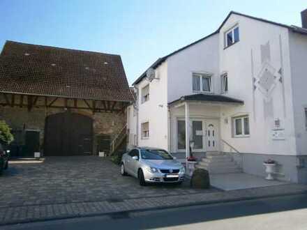 Attraktives und modernisiertes 7-Zimmer-Mehrfamilienhaus zum Kauf in Karben, Karben