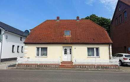 Einfamilienhaus mit Boddenblick und 2 Ferienhäusern in Breege zu verkaufen