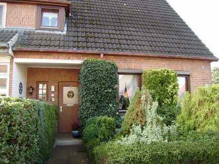 Doppelhaushälfte mit sehr schönem Garten in zentraler Lage