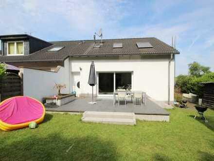 Modernes Eckhaus mit schönem Garten und schicker Einbauküche in exklusiver Wohnlage