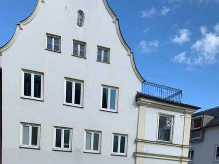 Wohn– und Geschäftshaus mit viel Potenzial in zentraler Lage