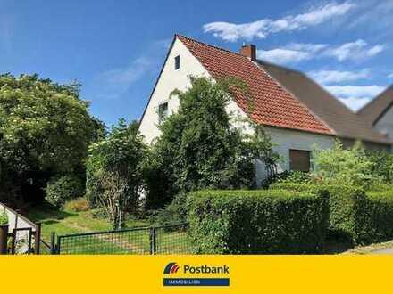 Kleines Einfamilienhaus mit großem Garten und Erweiterungspotential