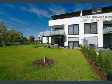 Exklusive Eigentumswohnung im Erdgeschoss mit Doppelgarage & Garten