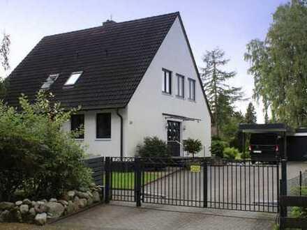 Modernisiertes Ein-bis Zweifamilienhaus  Doppelgarage und großes Grundstück