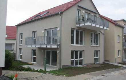 Schöne 2-Zimmer-Neubau-Wohnung mit ca. 49,6 m² Wohnfläche im EG mit Balkon, Kellerraum und Tiefga...