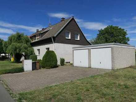 Doppelhaushälfte mit 2 Garagen und großem Grundstück in guter, grüner Lage Huckarde!
