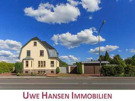 * Wülfrath-West: 3-Parteien-Haus mit großen Garagen! *