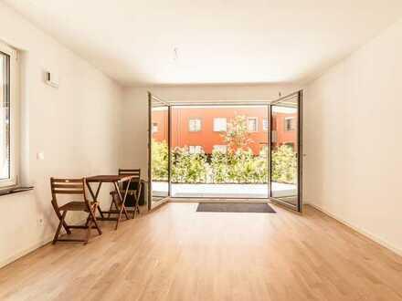 4-Zimmer Ergeschoss-Wohnung mit Süd-Terasse und Gemeinschafts-Dachgarten