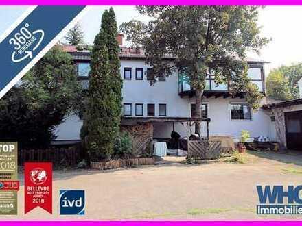 Vielseitig verwendbares 4-Familienhaus mit Gewerbeeinheit in Stuttgart-Rot