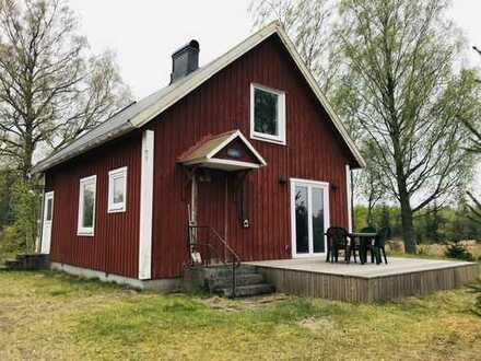 Renoviertes Ferienhaus in ruhiger Lage und 6,7 ha Land