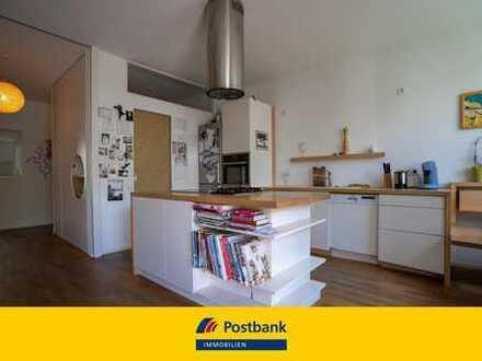 Besonders hochwertige vermietete KfW-70-Wohnung mit Balkon, zwei Bädern und drei Schlafzimmern