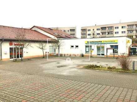 Wohn- und Geschäftshaus auf einem Grundstück