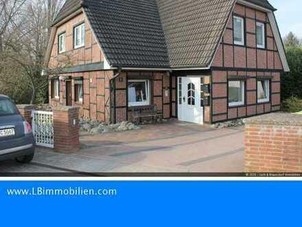 Gemütliche Erdgeschosswohnung mit Sonnenterrasse und Kamin zu verkaufen