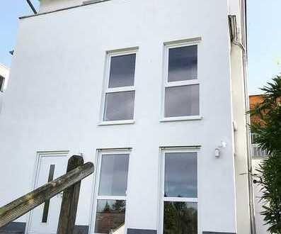 Schicke Eigentumswohnung im 2-Familienhaus mit eigenem Gartenanteil und Garage