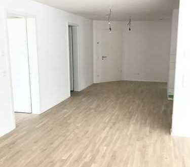 NEUBAU: Geräumige 4-Zimmer Wohnung mit Terrasse, großem Gartenanteil und 2 TG-Stellplätzen