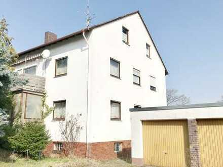 2-Familienhaus plus teilausgebautem Dachgeschoss und Doppelgarage in Bestlage