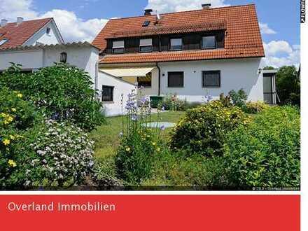 Familienfreundliches Zweifamilienhaus mit schönem Garten