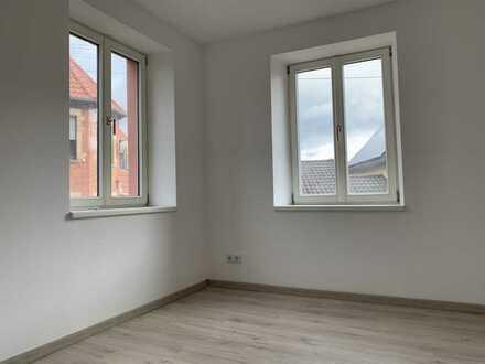 Erstbezug nach Sanierung: 3-Zimmer-Hochparterre-Wohnung mit großer Terrasse