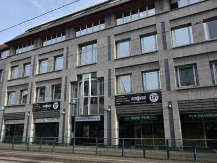 KUNZE: Zentrale 2-Zimmer Wohnung mit Balkon und Tiefgaragenstellplatz!
