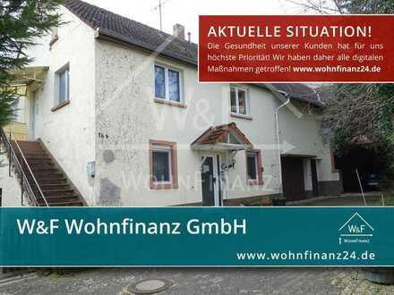 Erstbesichtigung direkt von zu Hause: 2-Familienhaus mit 4 Garagen, Scheune und viel Nutzfläche!