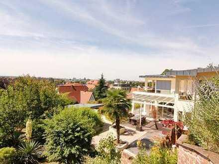 Axel Meisen Immobilien: Repräsentatives Luxus-Statement in mediterranem Gartenpark