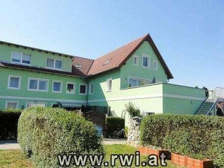 Eigentumswohnung mit 105 m² Wohnfläche, 38 m² Hochterrasse und 98 m² Eigengarten