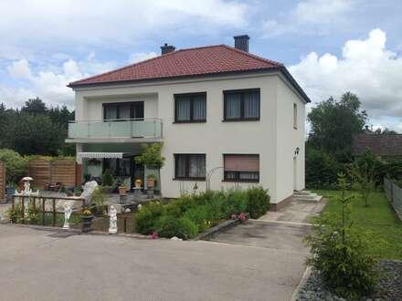Wohnung in Zweifamilienhaus mit Garten und Garage in Ruhelage