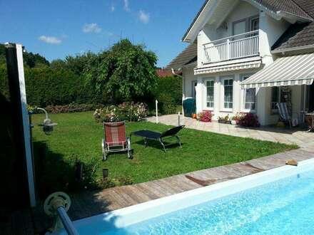Top gepflegtes Einfamilienhaus mit Doppelgarage und Pool
