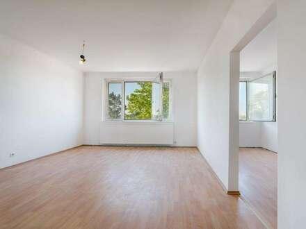 Günstige 4-Zimmer Familienwohnung - mit Garage, Ausblick und Grünblick zum Herrichten
