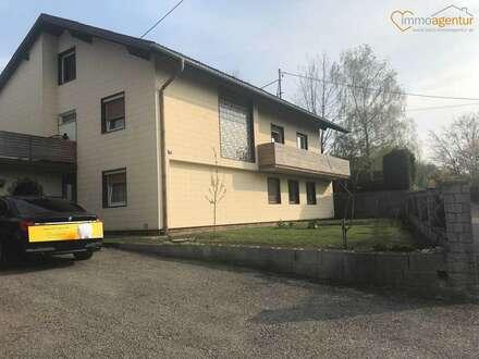 Mehrfamilienhaus mit Balkon, Terrasse, großem Garten, einer Doppelgarage und großzügiger Einfahrt in Ansfelden