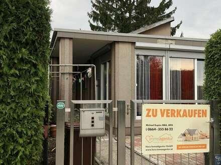 Preiswerter Bungalow mit ausgebautem Untergeschoss und gemütlicher Terrasse