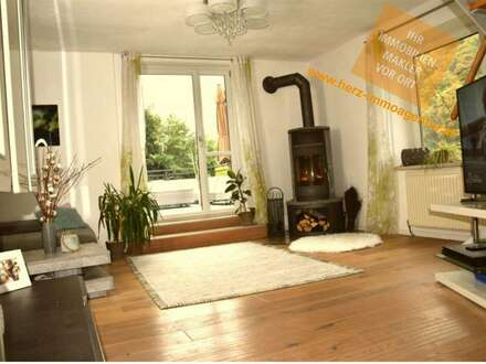 Hochwertiges Einfamilienhaus mit liebevoll angelegtem Garten, geringe Betriebskosten am Balkon von Linz in romantische Alleinlage!
