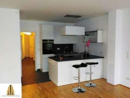 Neuwertige Gartenwohnung mit hochwertiger Ausstattung und Garagenplatz