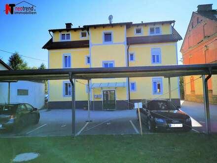 Hochwertige 2 Zimmer Wohnung mit Carport und eigenem Gartenanteil