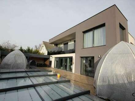 PAUL & Partner: Modernes Einfamilienhaus + Garage + Outdoorküche + Pool