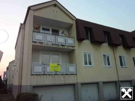 Erstbezug nach Sanierung - 3 Zimmer Eigentumswohnung im Halbstock mit Loggia und Garage!