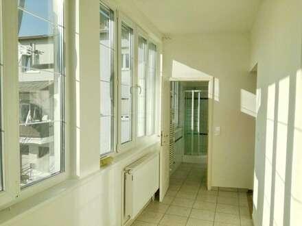 Sonnige Wohnung mit Veranda und schönem gartenseitigen Ausblick