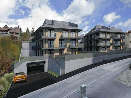 Hall i. T. (Neubau): Charmante 2-Zi.-Wohnung mit Terrasse und Garten