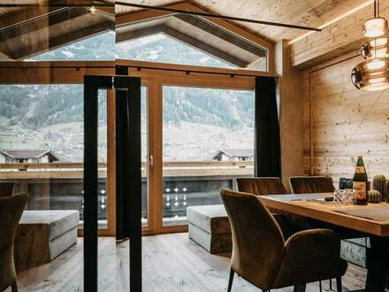 Modern and exclusive chalet converted into 4 luxury alpine apartments in a central location of the Zillertal