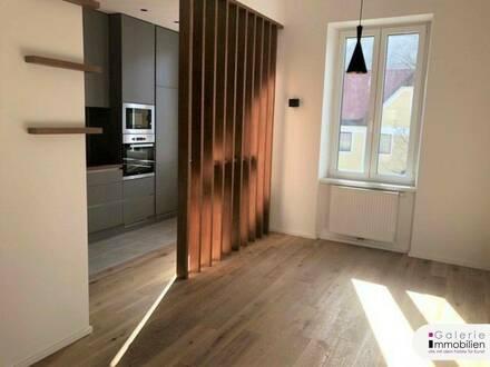 Charmante helle 2-Zimmer-Wohnung mit Eigengarten und Parkplatz - Grünblick